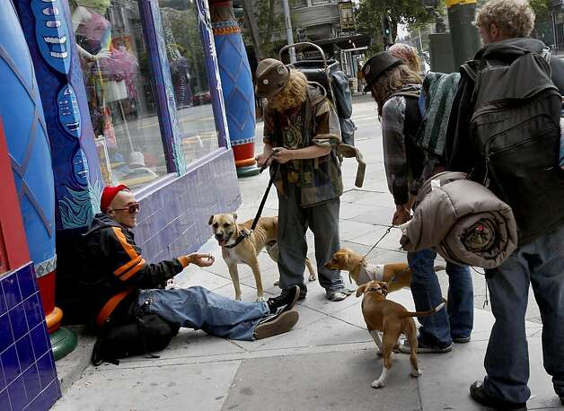 "A group of ""street kids"" stop to talk with a panhandler on Haight Street near Masonic Avenue. San Francisco's controversial sit lie law, which makes it against the law to sit or lie on a city sidewalk, is being enforced exclusively in the Haight Ashbury neighborhood. Photo: Brant Ward, The Chronicle"