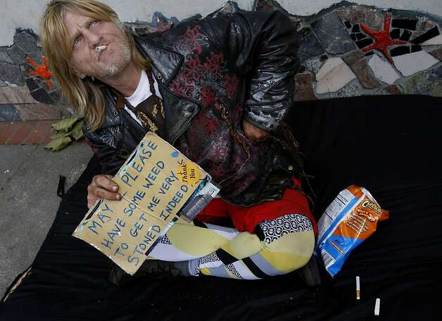Veteran panhandler John Scism sits on a quiet part of Haight Street. The city is trying to address long-term sit/lie offenders by the end of the summer. Photo: Brant Ward, The Chronicle