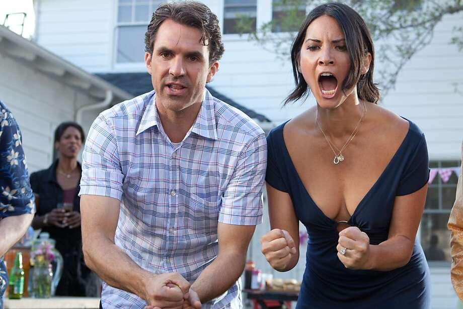 Paul Schneider as ÒTommyÓ and Olivia Munn as ÒAudreyÓ in THE BABYMAKERS. Photo: Dan McFadden, Millenium Entertainment