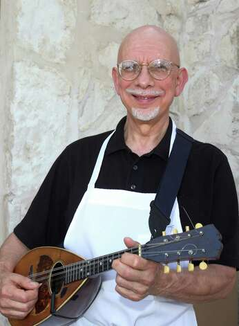 Owner Al DiLiberto poses with his mandolin Monday July 30, 2012 outside of his restraunt DiLiberto's. Photo: Julysa Sosa / SAN ANTONIO EXPRESS-NEWS