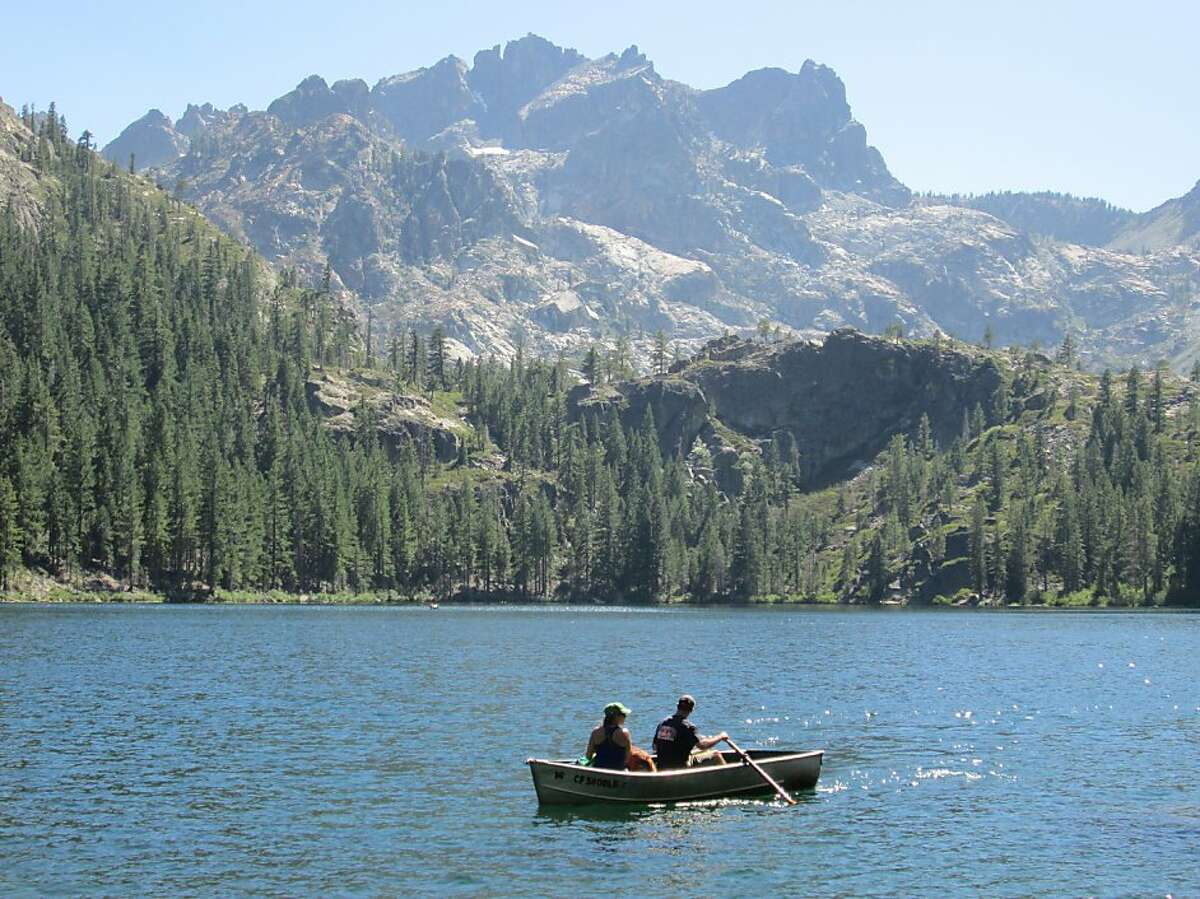 The Sierra Buttes tower over Sardine Lake. The resort has a small fleet of rental boats.