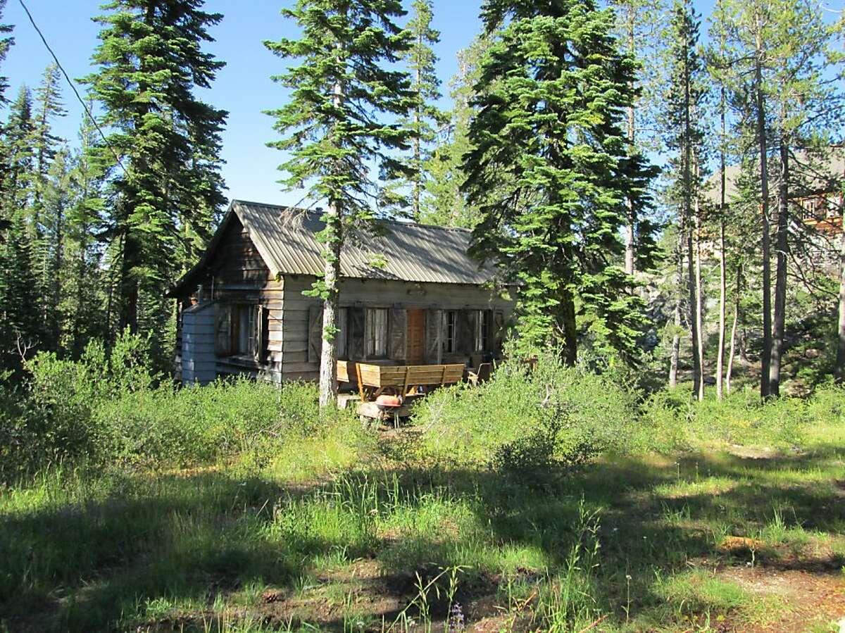 A woodsy cabin at Elwell Lakes Lodge -- there's 23 lakes within 3-mile radius