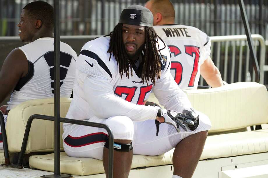 Derek Newton rides back to Reliant Stadium after an eventful practice Wednesday in which his role on the team came into sharper focus with an injury to fellow offensive lineman Duane Brown. Photo: Brett Coomer / © 2012 Houston Chronicle