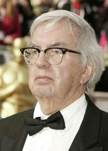 """Hollywood, UNITED STATES:  Writers Larry McMurtry arrives 05 March, 2006, for the 78th Academy Awards at the Kodak Theater in Hollywood, California. He is nominated for Best Adapted Screenplay for the film """"Brokeback Mountain.""""   AFP PHOTO/ROBYN BECK  (Photo credit should read ROBYN BECK/AFP/Getty Images) Photo: ROBYN BECK / AFP"""