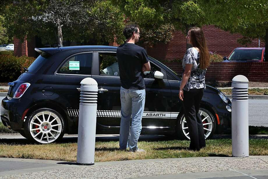 Customer Edward Fairchild (left) from Sunnyvale, looking at the Fiat 500 Abarth at Fiat of Fremont in Newark, California, asking questions to salesperson Nicole Armstrong (right) on Friday, June 1, 2012. Photo: Liz Hafalia, The Chronicle