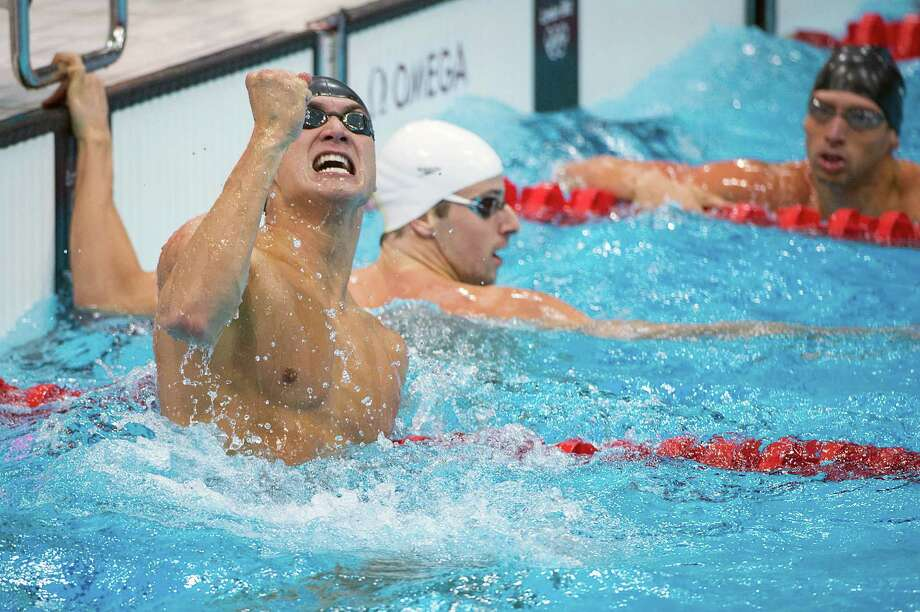 American Nathan Adrian pumps his first after edging Australian James Magnussen (center) by one-hundredth of a second for gold in the 100-meter freestyle. Photo: Smiley N. Pool, Houston Chronicle / © 2012  Houston Chronicle