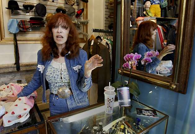 Cicely Ann Hansen, owner of the Decades of Fashion clothing store on Haight Street, says she calls police to report people sitting or lying on the sidewalk. Photo: Brant Ward, The Chronicle