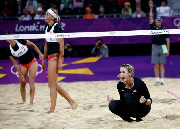 United States' Kerri Walsh, right, reacts after making a shot against Austria's Doris Schwaiger and Stefanie Schwaiger during a beach volleyball match at the 2012 Summer Olympics, London, Thursday, Aug. 2, 2012. Photo: Jae C. Hong