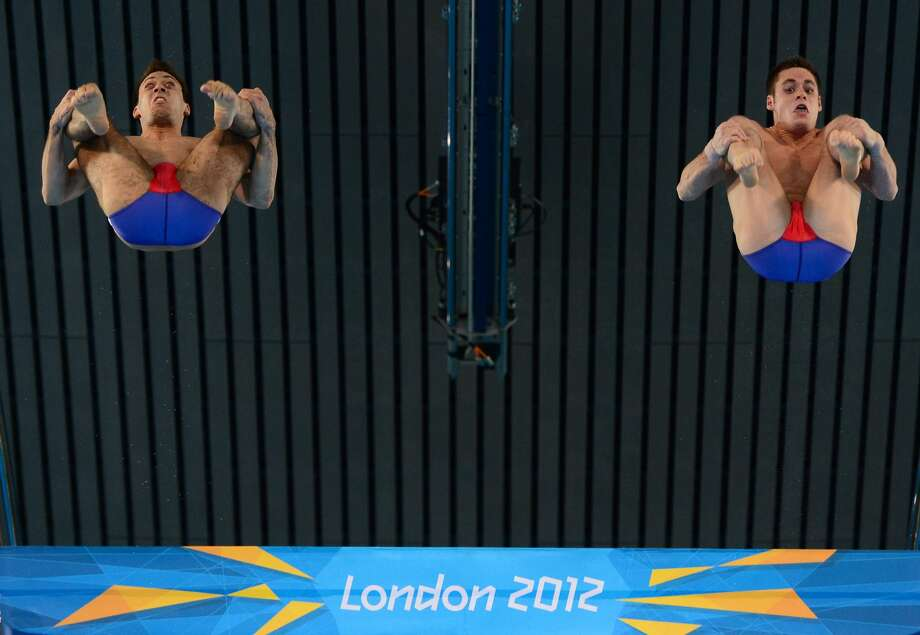 US diver Nicholas McCrory, competing with David Boudia, sees what awaits them. It ain't pretty. (CHRISTOPHE SIMON/AFP/GettyImages) (AFP/Getty Images)