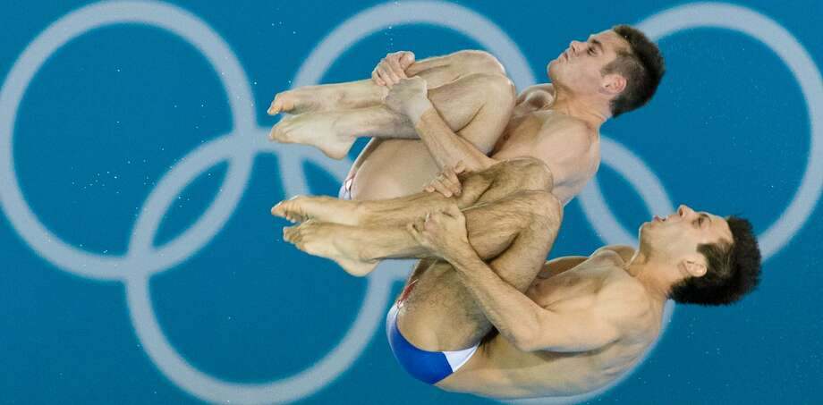 US diver Nicholas McCrory lets loose with primal scream, we think, as he competes with David Boudia. (LEON NEAL/AFP/GettyImages) (AFP/Getty Images)