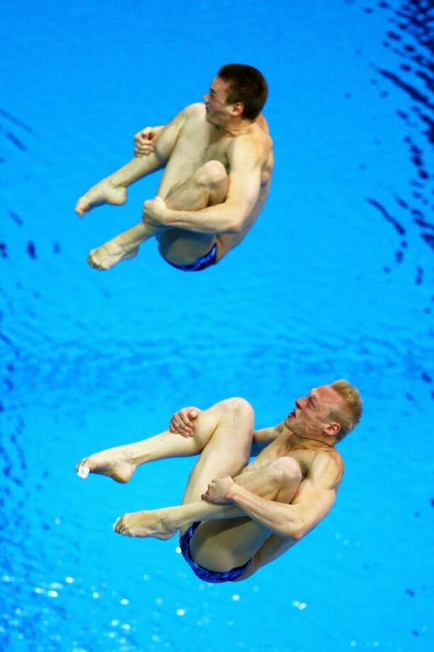 Oh, man, this sucks! What else could Troy Dumais (top) and Kristian Ipsen (bottom) of the U.S. be thinking Wednesday at the 3-meter springboard final.  (Photo by Al Bello/Getty Images) (Al Bello / Getty Images)