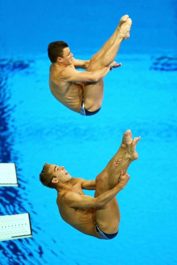 Be careful or you will bite your tongue off. And maybe poke your eye out, too. You can tell Kristian Ipsen, bottom, is from the U.S., where biting on your tongue is a time-honored sign of concentration. He is diving with Troy Dumais on Wednesday.  (Photo by Al Bello/Getty Images) (Al Bello / Getty Images)