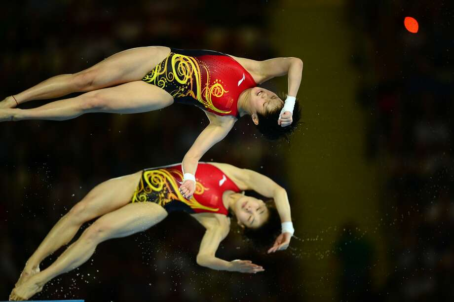 Here is what you could expected from China's Chen Ruolin and Wang Hao, who won gold on Tuesday. Just another day at the office. (MARTIN BUREAU/AFP/GettyImages) (AFP/Getty Images)
