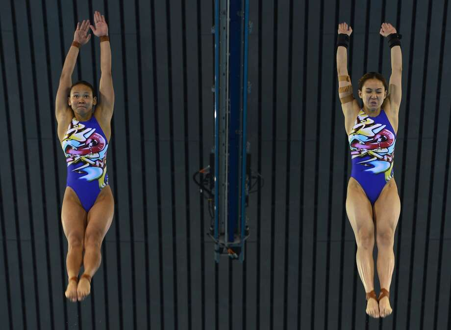Malaysia's Pamg Pandelela Rinong seems to understand just what she has gotten herself into. She is diving with teammate Mun Yee Leong on Tuesay. ( FABRICE COFFRINI/AFP/GettyImages) (AFP/Getty Images)