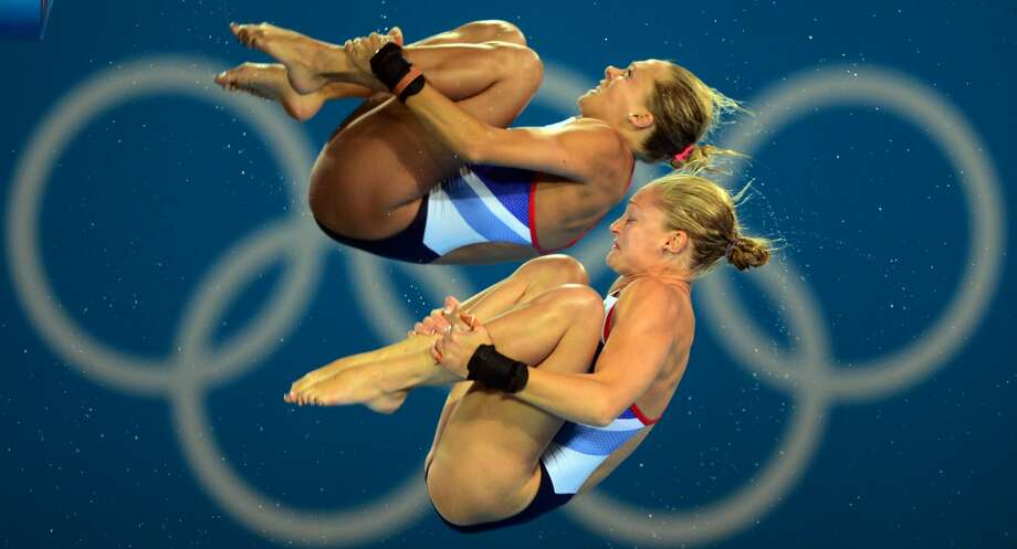 We are so happy to be here. Britain's divers Sarah Barrow and Nora Subschinski compete seem rather miffed Tuesday.  (MARTIN BUREAU/AFP/GettyImages) (AFP/Getty Images)