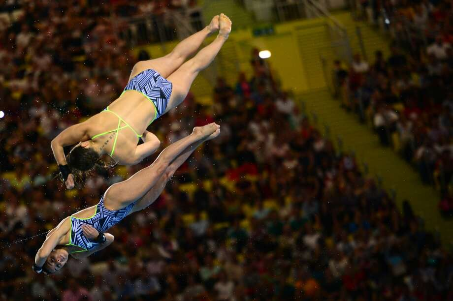 I don't know? Where do you want to eat tonight? Canada's divers Roseline Filion and Meaghan Benfeito tranquilly fall in the pool Tuesday. (MARTIN BUREAU/AFP/GettyImages) (AFP/Getty Images)