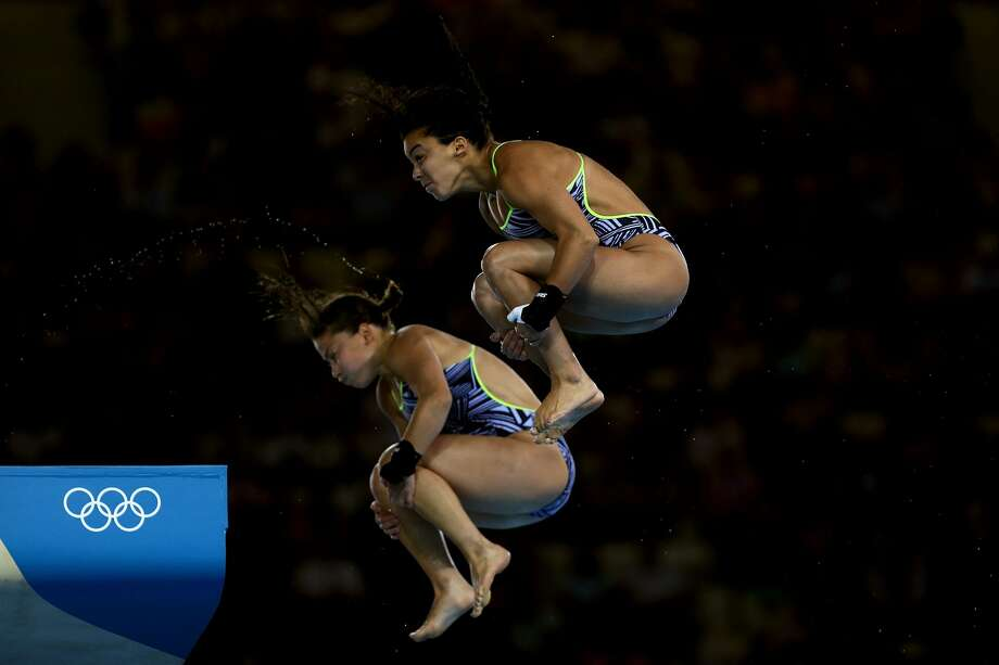 Heck, I'd hold my breath. too, Rosey. Roseline Filion and Meaghan Benfeito of Canada compete Tuesday.  (Photo by Clive Rose/Getty Images) (Clive Rose / Getty Images)