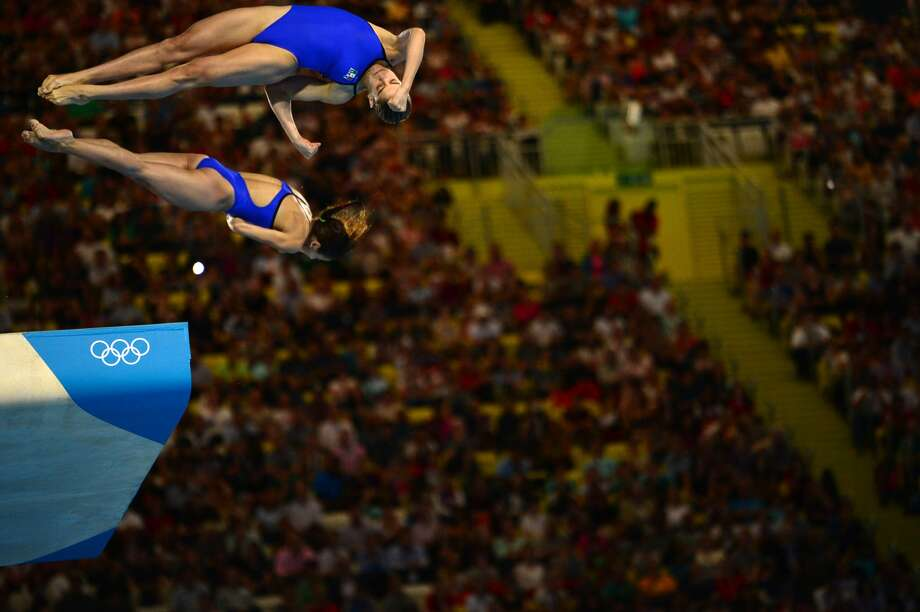 I won't look down. You can't make me. Mexico's divers Alejandra Orozco Loza and Paola Espinosa Sanchez compete Tuesday.  (MARTIN BUREAU/AFP/GettyImages) (AFP/Getty Images)