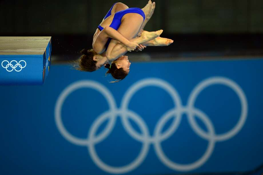 Do you see what I see?  Mexico's divers Alejandra Orozco Loza and Paola Espinosa Sanchez compete Tuesday. (MARTIN BUREAU/AFP/GettyImages) (AFP/Getty Images)