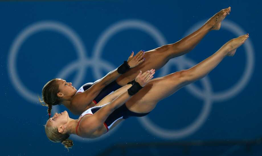 Do my toes look funny to you? Tonia Couch of Great Britain make sure she still has 10. She is diving with Sarah Barrow on Tuesday. (Photo by Clive Rose/Getty Images) (Clive Rose / Getty Images)