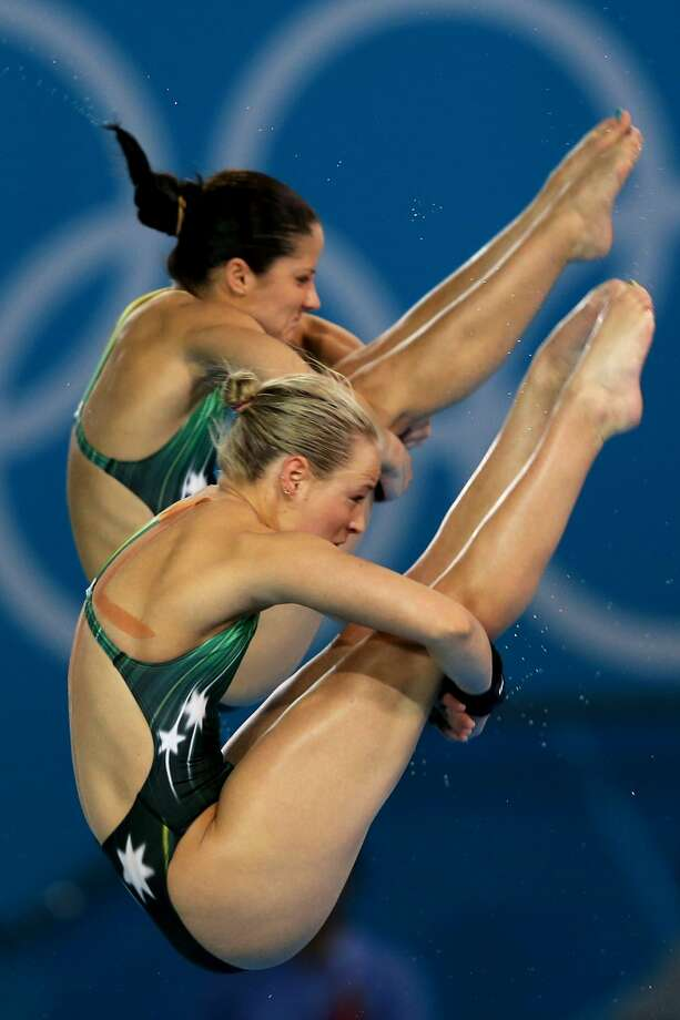 Rachel Bugg (foreground) and Loudy Wiggins of Australia are quite occupied as they compete Tuesday. (Photo by Clive Rose/Getty Images) (Clive Rose / Getty Images)