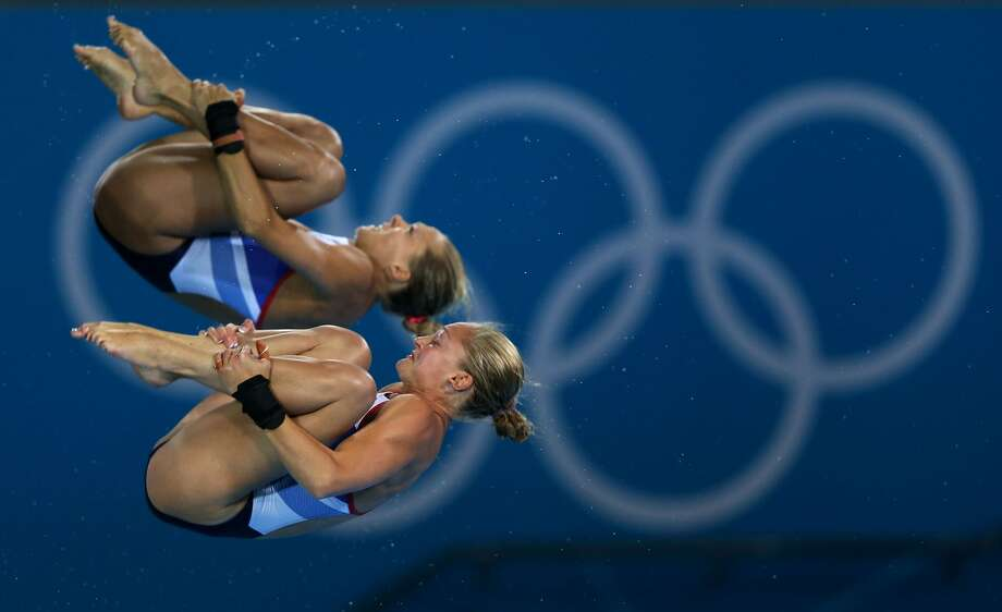 Two British divers seem to be questioning their career choices -- a little late. Sarah Barrow (foreground) and Tonia Couch of Great Britain compete on Tuesday.  (Photo by Clive Rose/Getty Images) (Clive Rose / Getty Images)