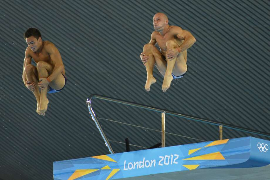 Just how long does Peter Waterfield of Great Britain expect to be under water? Either that or he's saving lunch to chew after he hits the pool. He's diving with Thomas Daley.  (ODD ANDERSEN/AFP/GettyImages) (AFP/Getty Images)