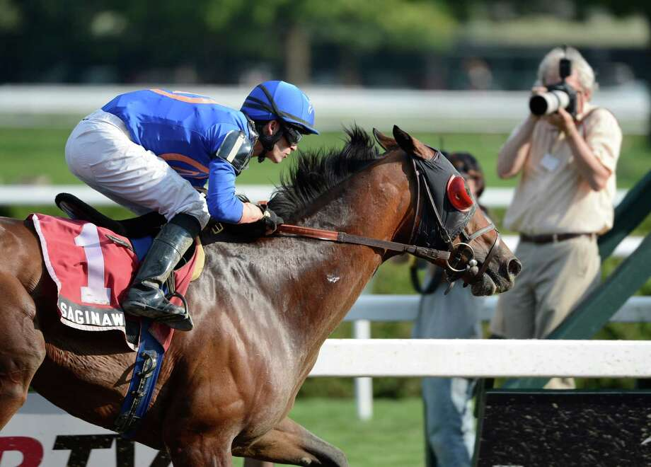 Saginaw ridden by David Cohen is captured by the photographers at the track while winning The 9th running of The John Morrissey Stake at the Saratoga Race Course in Saratoga Springs, N.Y. Aug 1, 2012.    (Skip Dickstein/Times Union) Photo: Skip Dickstein