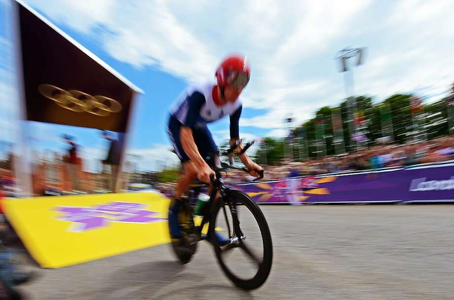 Britain's gold medalist Bradley Wiggins starts competing in the London 2012 Olympic Games men's individual time trial road cycling event in London on August 1, 2012. AFP PHOTO / CARL DE SOUZACARL DE SOUZA/AFP/GettyImages Photo: Carl De Souza, AFP/Getty Images