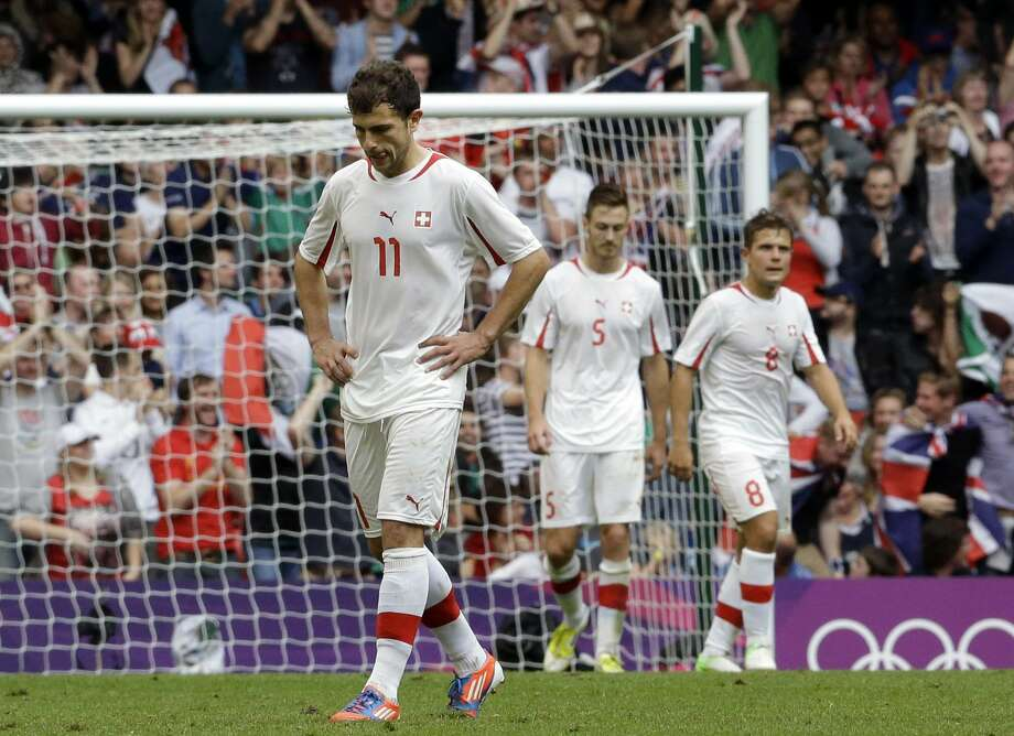 Switzerland's Admir Mehmedi looks on after Mexico's Oribe Peralta scored, during the men's group B soccer match between Mexico and Switzerland, at the Millennium stadium in Cardiff, Wales, at the 2012 London Summer Olympics, Wednesday, Aug. 1, 2012. (Luca Bruno / Associated Press)