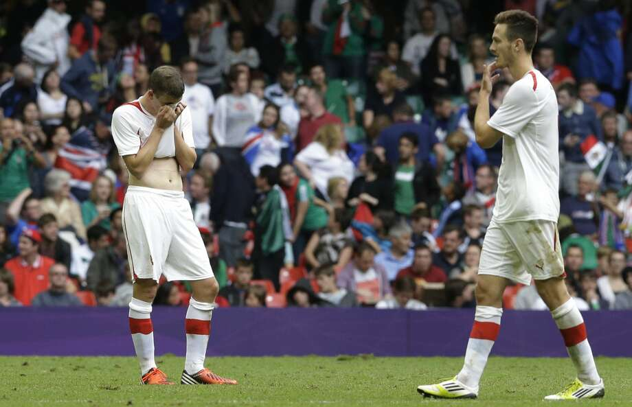 Switzerland's Fabian Frei, left, reacts at the end the men's group B soccer match between Mexico and Switzerland, at the Millennium stadium in Cardiff, Wales, at the 2012 London Summer Olympics, Wednesday, Aug. 1, 2012. Mexico won 1-0 and advances to the quarterfinals. (Luca Bruno / Associated Press)