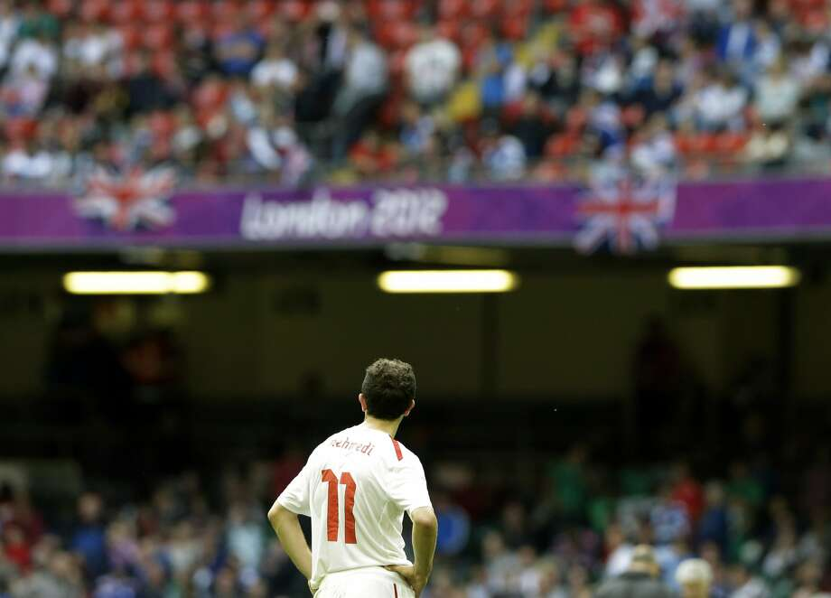 Switzerland's Admir Mehmedi reacts at the end the men's group B soccer match between Mexico and Switzerland, at the Millennium stadium in Cardiff, Wales, at the 2012 London Summer Olympics, Wednesday, Aug. 1, 2012. Mexico won 1-0 and advances to the quarterfinals. (Luca Bruno / Associated Press)