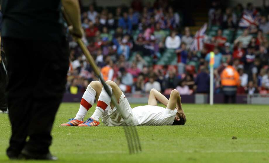 Switzerland's Admir Mehmedi lies on the ground at the end the men's group B soccer match between Mexico and Switzerland, at the Millennium stadium in Cardiff, Wales, at the 2012 London Summer Olympics, Wednesday, Aug. 1, 2012. Mexico won 1-0 and advances to the quarterfinals. (Luca Bruno / Associated Press)