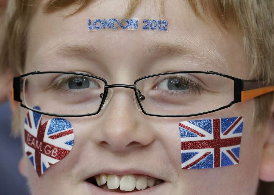 A British supporters smiles during the men's group B soccer match between Mexico and Switzerland, at the Millennium stadium in Cardiff, Wales, at the 2012 London Summer Olympics, Wednesday, Aug. 1, 2012. (Luca Bruno / Associated Press)