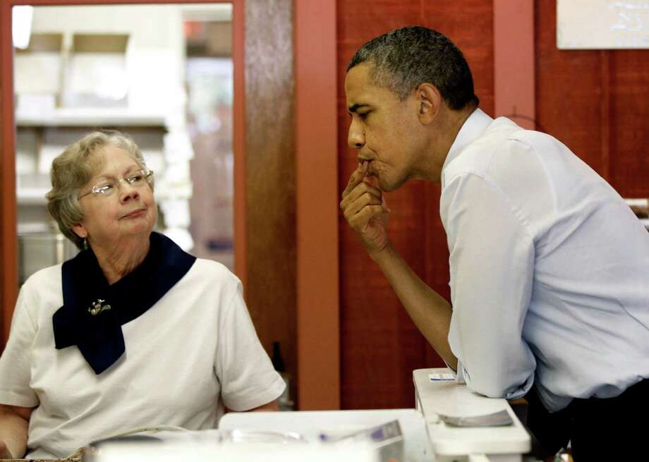 President Barack Obama samples some fudge given to him by LaDonna Secrist, owner of the Squirrel's Den, during a stop Wednesday in Mansfield, Ohio. Photo: Pablo Martinez Monsivais / AP