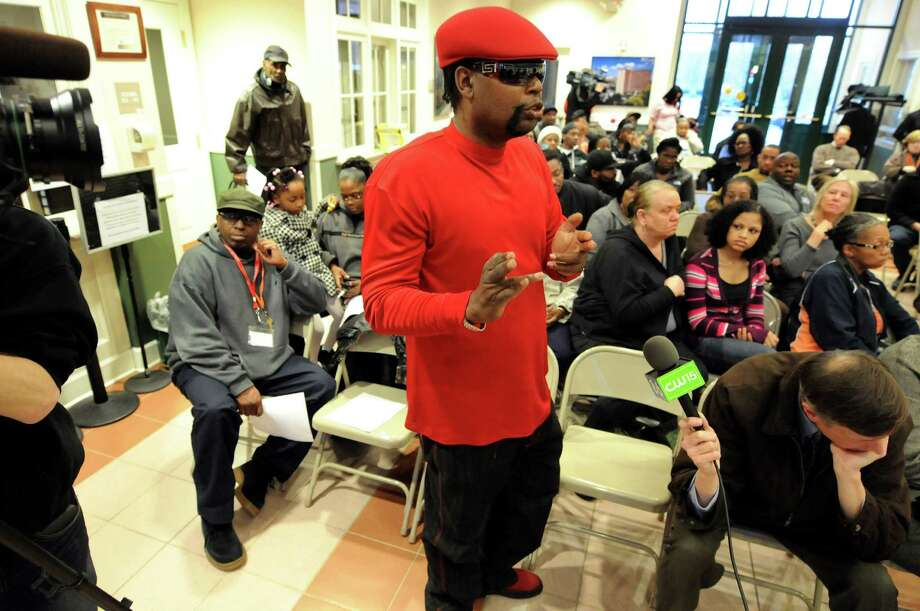 Community advocate Marlon Anderson of Albany, center, questions Albany County District Attorney David Soares about the Grand Jury's decision regarding the death of Nah-Cream Moore on Thursday, March 29, 2012, at Albany Housing Authority in Albany, N.Y. (Cindy Schultz / Times Union) Photo: Cindy Schultz / 00017030A