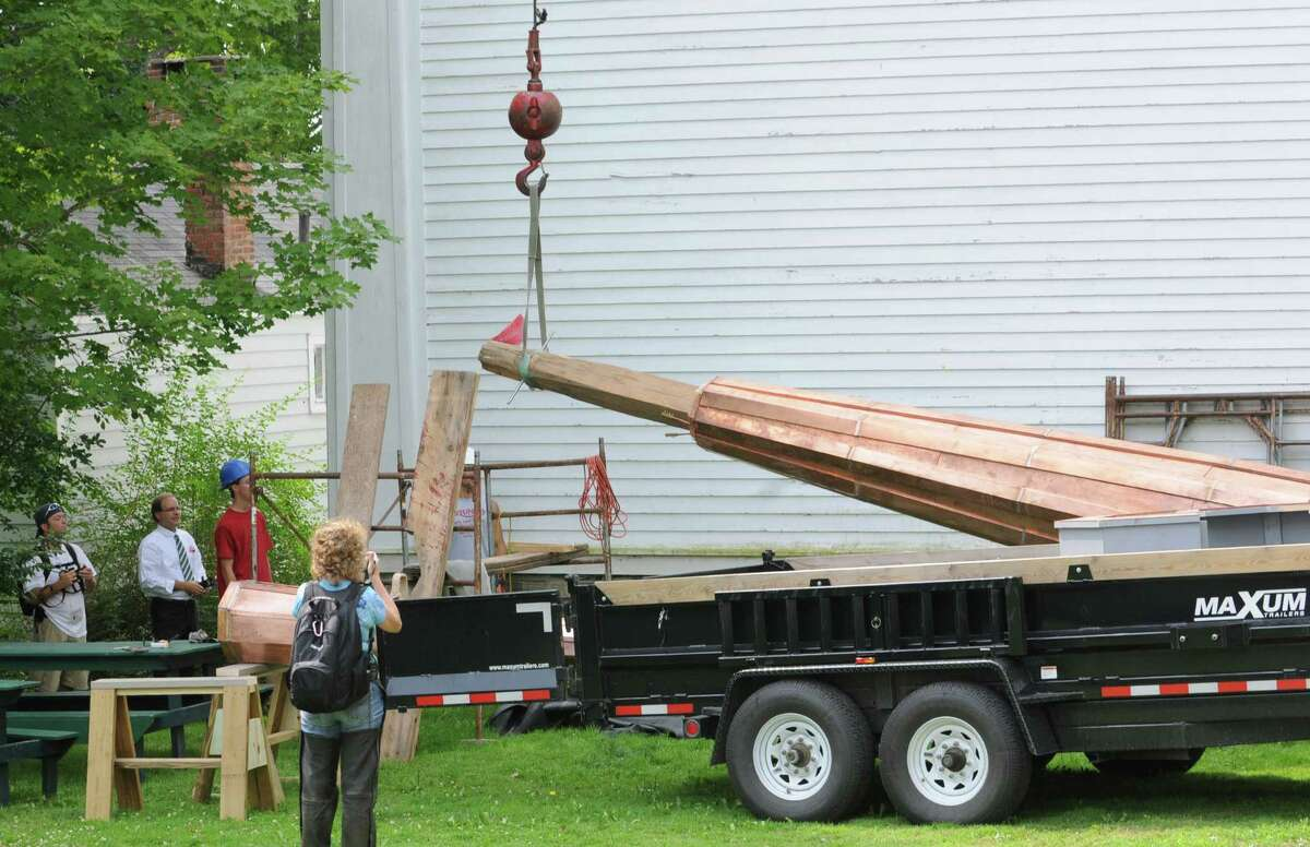 The spire of the Rensselaerville Presbyterian church is lifted and placed once again atop the steeple on Wednesday, August 1, 2012 in Rensselaerville, N.Y. (Lori Van Buren / Times Union)