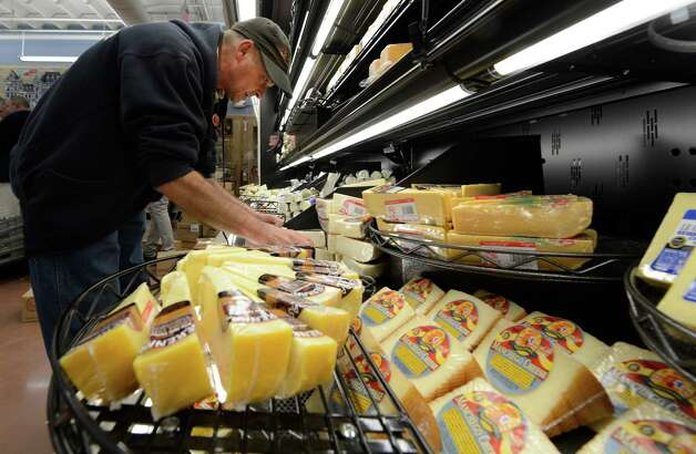 Pierre Perrier stocks cheese products  at the new Trader Joe's in Colonie.      (Skip Dickstein / Times Union) Photo: Skip Dickstein / 00018537A