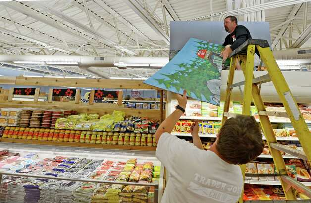 Workers put finishing touches on artwork, which reflects the local area.      (Skip Dickstein/Times Union) Photo: Skip Dickstein / 00018537A