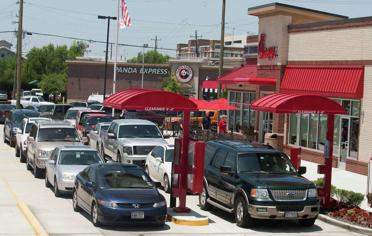 """Vehicles line up at the drive-thru at the Shearn Street location after former Arkansas Gov. Mike Huckabee declared it """"Chick-fil-A Appreciation Day."""""""