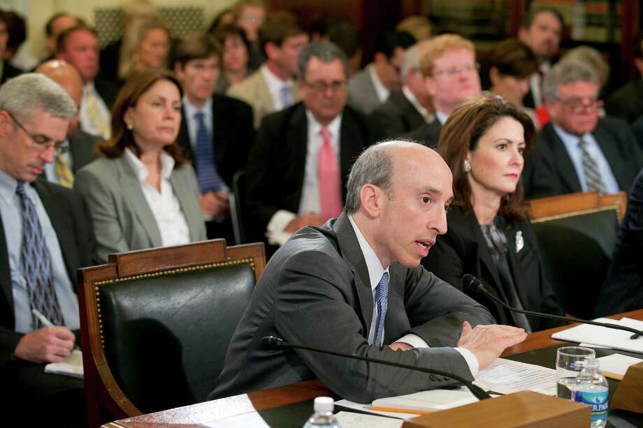 Gary Gensler, chairman of the Commodity Futures Trading Commission (CFTC), center, and Jill Sommers, commissioner of the CFTC, testify during a Senate Agriculture Committee hearing in Washington, D.C., U.S., on Wednesday, Aug. 1, 2012. MF Global Holdings Ltd.'s brokerage customers, facing a $1.6 billion gap in funds, will eventually recoup their money, according to the trustee overseeing the parent company's liquidation. Photographer: Andrew Harrer/Bloomberg *** Local Caption *** Jill Sommers; Gary Gensler Photo: Andrew Harrer, Bloomberg / © 2012 Bloomberg Finance LP