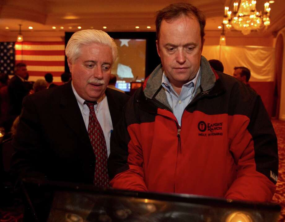Harris County Clerk Stan Stanart, left, shown with Keen Butcher on Election Night 2010, says voters should have faith in his office. Photo: James Nielsen / Houston Chronicle