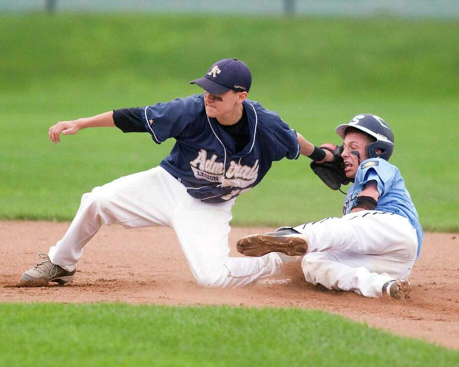 Bethel's Walter Frank tags out Stamford's Billy Murphy trying to steal in the Junior American Legion state tournament game Wednesday night at Bethel High School. Photo: Barry Horn
