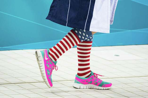 Kathleen Hersey of the USA wears patriotic socks as she arrives for the women's 200-meter butterfly swimming final at the 2012 London Olympics on Wednesday, Aug. 1, 2012. Photo: Smiley N. Pool, Houston Chronicle / © 2012  Houston Chronicle