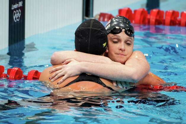 Cammile Adams of the USA, facing, hugs teammate Kathleen Hersey after the women's 200-meter butterfly swimming final at the 2012 London Olympics on Wednesday, Aug. 1, 2012. Hersey took fourth and Adams fifth in the race. Photo: Smiley N. Pool, Houston Chronicle / © 2012  Houston Chronicle