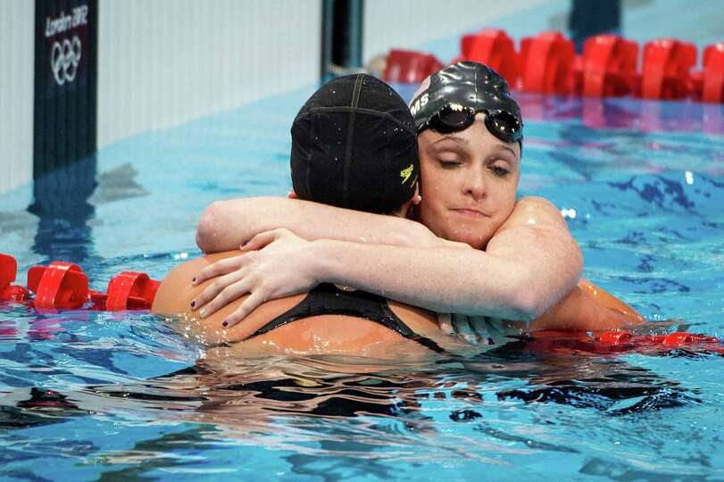 Cammile Adams of the USA, facing, hugs teammate Kathleen Hersey after the women's 200-meter butterfl