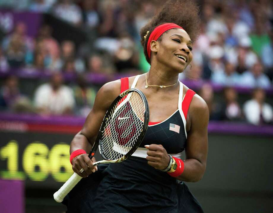 Serena Williams of the USA celebrates the final point of her win over Vera Zvonareva of Russia in a women's singles tennis match at Wimbledon during the 2012 London Olympics on Wednesday, Aug. 1, 2012. Photo: Smiley N. Pool, Houston Chronicle / © 2012  Houston Chronicle