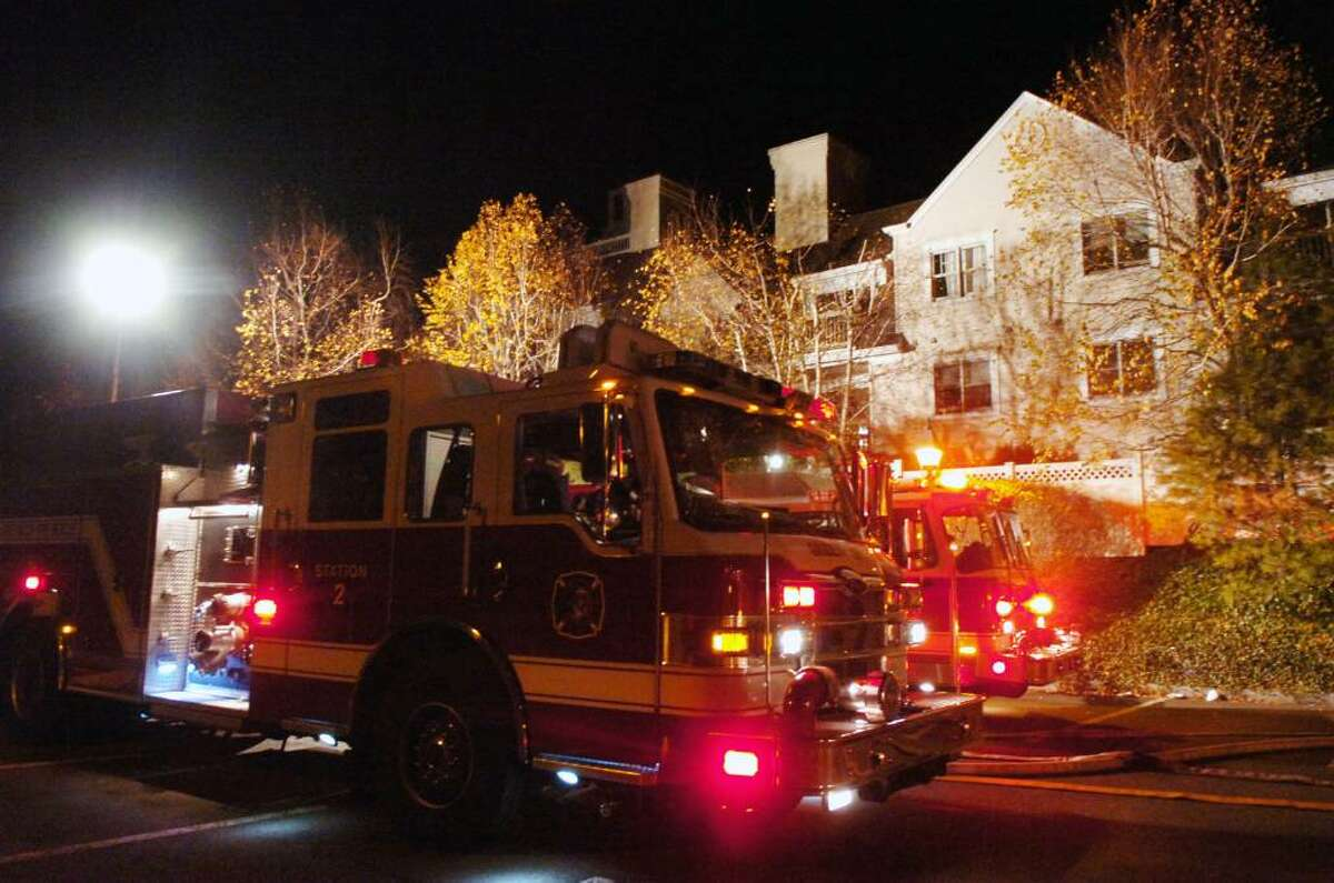 Firetrucks line the street during a structure fire at the Old Greenwich Gables condominium complex at 51 Forest Avenue late Tuesday, Dec. 1, 2009. The fire spread through several units displacing numerous residents and causing extensive damage to exterior of the building; the battle to contain it went well into the night.