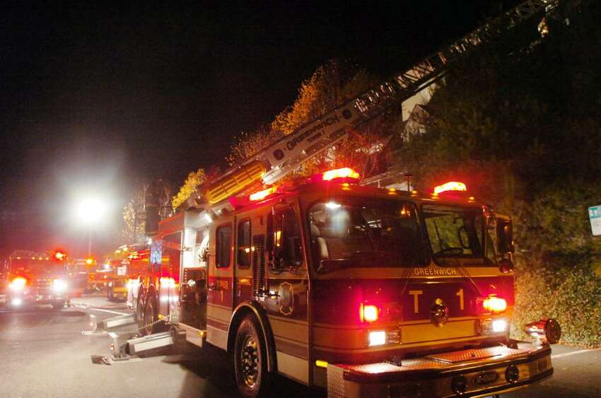 Firetrucks line the Old Greenwich Train Station on the backside of the Old Greenwich Gables condominium complex at 51 Forest Avenue which suffered a structure fire late Tuesday, Dec. 1, 2009. The fire spread through several units displacing numerous residents and causing extensive damage to exterior of the building; the battle to contain it went well into the night.