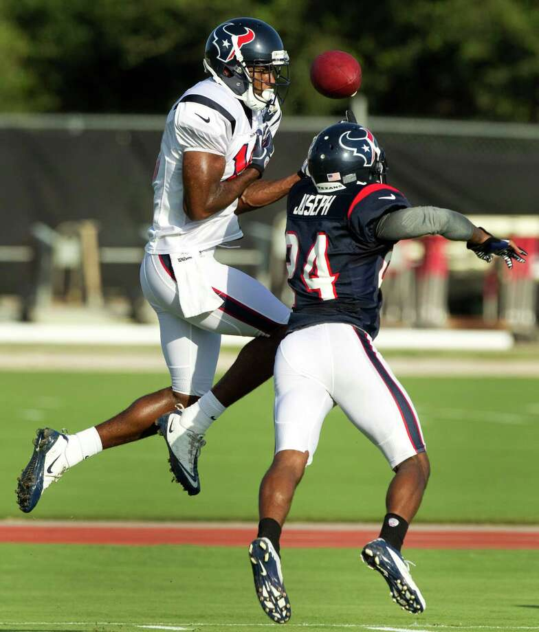 Johnathan Joseph, right, serves notice to wide receiver Lestar Jean during Wednesday's practice why he is considered the Texans' shutdown cornerback. Photo: Brett Coomer / © 2012 Houston Chronicle